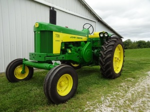 John Deere 730 Row Crop wide front tractor, diesel, 59HP, power steering, 1959 model SN 7313779, 6 speed, hydraulic remotes, power steering, three front weights..  Completely restored and parade ready.