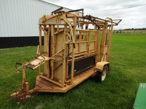 For-Most 450 portable cattle squeeze chute with model 30 head gate, palpation cage with sliding gate and head table.