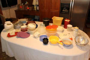 Strainers, ash trays, tupperware, mixer, cake platter, misc.