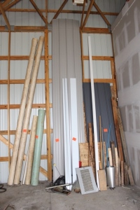 Sheet Metal, Plywood, Misc. Wood, J Channel, 4 pieces of PVC pipe, and misc.