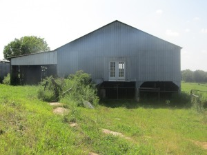 Parcel 2: 2.438 acres has large 2 story feed barn, with ramp to loft, side & end sheds & cattle handling area, 2 bay tool shed w/ ear corn crib in center, shop w/ 2 enclosed sheds and 1 open bay, storage room and has frontage on Smiley Basham and Aubrey L
