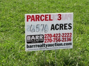 Parcel 3: 6.576 acres, all open and has frontage on Aubrey Lane. Parcel 3 is subject to a cemetary area and 20 ftl. easement to cemetary. All is part of total acreage of Parcel 3. ALL LOTS WILL REMAIN OPEN FOR BIDS UNTIL BIDDING ON EACH LOT HAS ENDED.