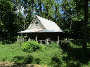 Parcel 8: 14.291 acres, open and wooded land with 1 ½ story rustic cabin off the grid; large porch, 60 x 60 hay barn and cattle loading bin. ALL LOTS WILL REMAIN OPEN FOR BIDS UNTIL BIDDING ON EACH LOT HAS ENDED.