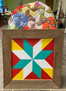 3rd Grade - Mrs. Mitcham's Class: 50 in x 60 in. Hand Quilted Lap Quilt (made by Linda Mitcham), Wooden Quilt Block Wall Hanging (Made by Josh Mitcham)
