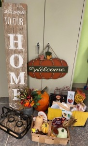 4th Grade - Mrs. Rothrock's Class: Welcome to Our Home Sign, Pumpkin Welcome Sign, Wire Basket with 6 Mason Jars, Large Pumpkin, Basket of Boehman Bee  Honey, Gourds, Squash, Candle, Pot Holders and Indian Corn
