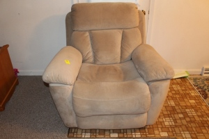 Cushioned rocking recliner