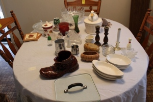 Assorted glassware, decorations, glass punch bowl, candle holders, duck cookie jar, and misc.