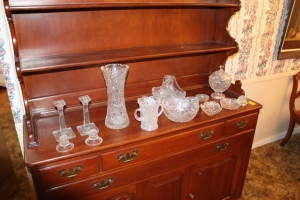 Assorted cut glass candy dishes, candle holders, and vases