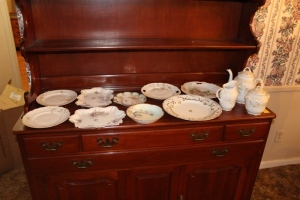 Assorted china plates, platters, and teapot