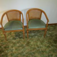 Two wooden chairs with upholstery