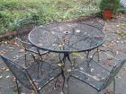 Wrougt iron table and 4 chairs